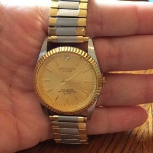 Men's silver and gold water resistant watch
